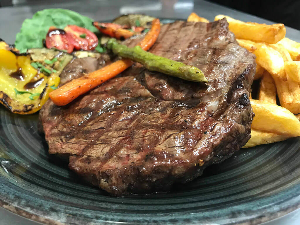 Ribeye Steak with Vegetables and Fries