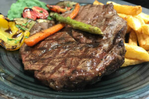 Ribeye with vegetables and Fries